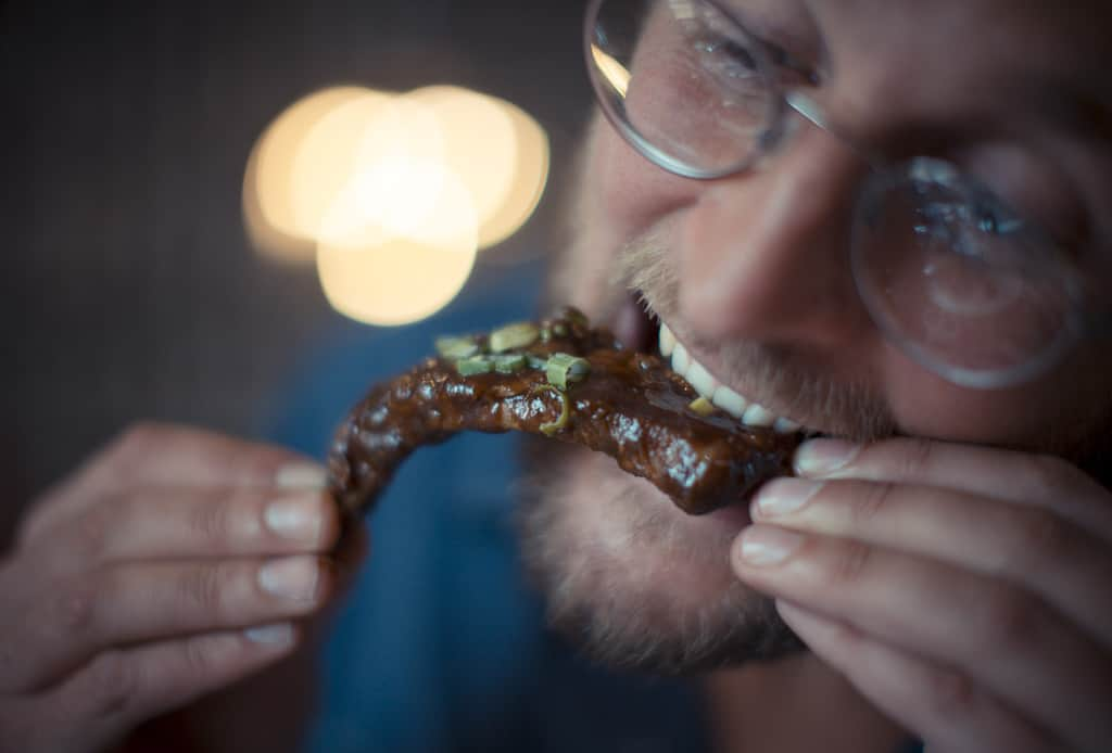 Our man tackling a a meaty rib: Harry's Bar Review