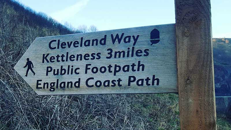 The Cleveland Way signpost in Sandsend