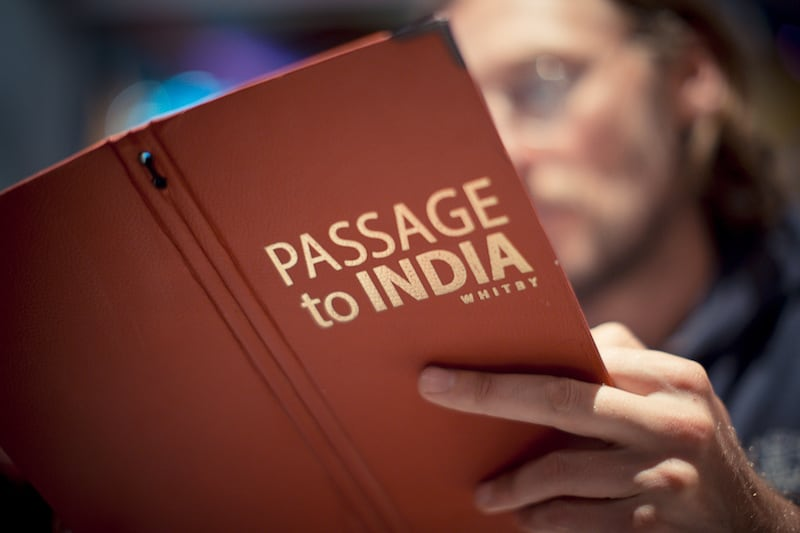 Our man perusing the menu at Passage to India Whitby