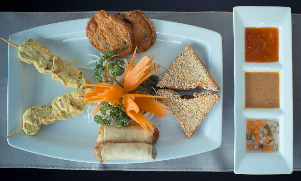 Kam Thai Mixed Starter; Prawn Toast, Thai Fish Cakes, Vegetable Spring Rolls, Chicken Satay with Authentic Dips