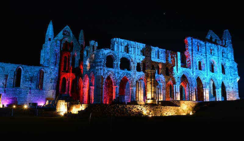 Whitby Abbey is iIlluminated for Whitby Goth weekend so night time visitors can walk amongst the ruins which inspired Bram Stoker's Dracula while spooky costumed characters bring alive the past. Picture by Martin Grimes/Getty Images