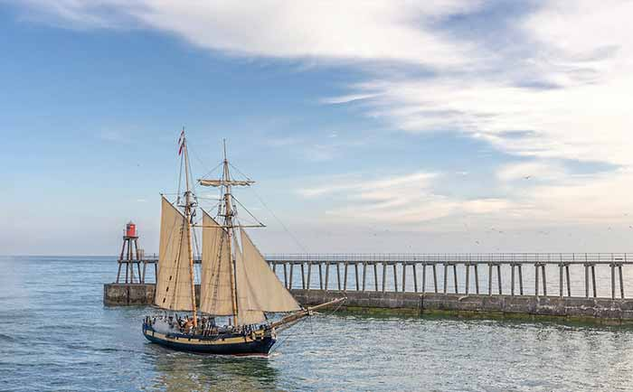 Ship entering Whitby harbour