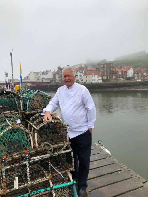 Brian Turner outside The Magpie Cafe in Whitby