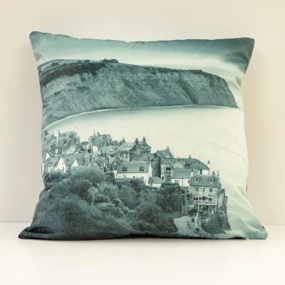 Double-sided Robin Hood's Bay velvet cushion in black and white